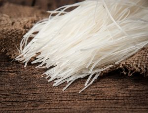 Rice noodles on wood background