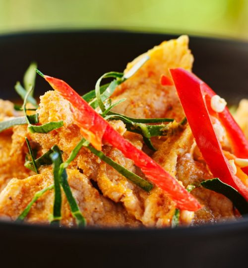 thai panang curry in bowl with pork